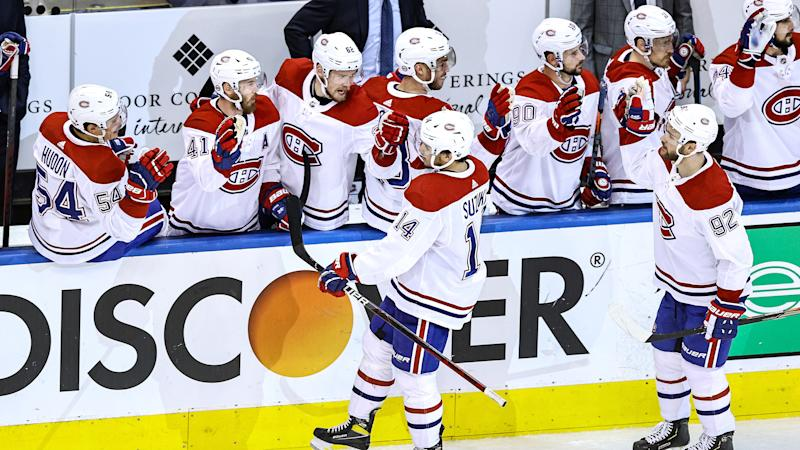 TORONTO, ONTARIO - AUGUST 19: Nick Suzuki #14 of the Montreal Canadiens celebrates with his teammates after scoring a goal against the Philadelphia Flyers at 10:59 during the third period in Game Five of the Eastern Conference First Round during the 2020 NHL Stanley Cup Playoffs at Scotiabank Arena on August 19, 2020 in Toronto, Ontario. (Photo by Elsa/Getty Images)
