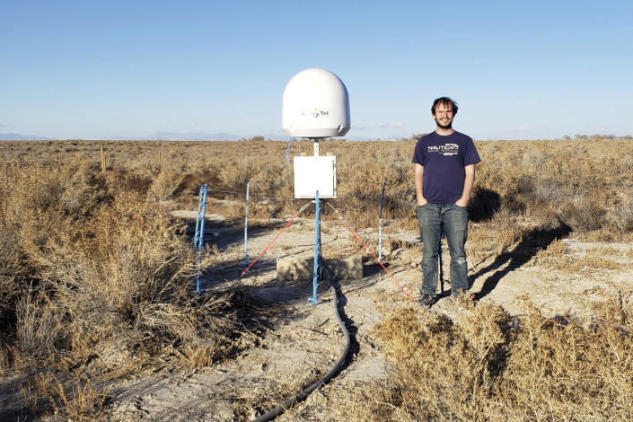CORRECTS TO NOV. 4 NOT NOV. 5 - This undated photo provided by Caltech shows radio astronomer Christopher Bochenek with a STARE2 station he developed near the town of Delta, Utah. On Wednesday, Nov. 4, 2020, astronomers say they used this system and a Canadian observatory to trace an April 2020 fast cosmic radio burst to our own galaxy and a type of powerful energetic young star called a magnetar. (Caltech via AP)