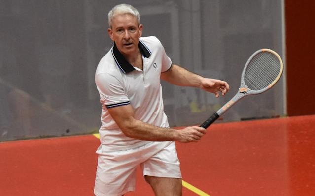 """As a middle-aged reporter, there are few experiences more rare and precious than meeting a world-class sportsman whose hair is whiter than your own. Rob Fahey is a case in point. The most successful player in the history of real tennis, he is about to take on a young American named Camden Riviere for the world championship title. The fact that Fahey will celebrate his 50th birthday on Monday week doesn't seem to bother him, although he does admit that """"I'm going to be the biggest underdog since the 1930s."""" Real tennis – Henry VIII's favourite game, and the ancestor of Wimbledon's """"lawn"""" tennis – is a fine choice for a silver fox, because wiliness outperforms fitness every time. The rules of this bizarre sport – a Byzantine combination of tennis, squash and pinball – are too complex to detail here. Suffice it to say that each point (or """"reste"""", technically) begins with the ball being served onto a sloping roof, known as the penthouse. It then gurgles its way around the court before landing with the chanciness of a roulette wheel. Through sheer experience, a 70-year-old with two false hips is more likely to make the return than a fit young debutant. The basic layout of a real tennis court was established back in the 16th century Credit: DAVID BURGES Yet while brains might be essential, brawn plays its part too. Next week's play-off is a three-day event scheduled for Tuesday, Thursday and Saturday. Fahey and Riviere are likely to spend around three hours on court each time, followed by a rest day which offers opportunity for deep tactical analysis in the manner of a Fischer-Spassky chess series. """"The thing which distinguishes the top guys from the club players is usually the ability to read the spin,"""" says Riviere of a sport with at least 15 styles of service, each named after its inventor. """"The ball sometimes strikes six different surfaces before you hit it."""" Before world championships, players are banned from watching their rivals practise, in case they pick up clues"""