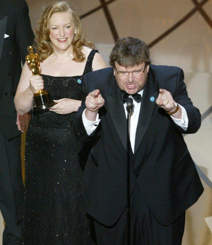 "Michael Moore accepts his Oscar alongside wife and ""Bowling for Columbine"" producer Kathleen Glynn. (Photo: Brian Vander Brug/Getty Images)<br>"