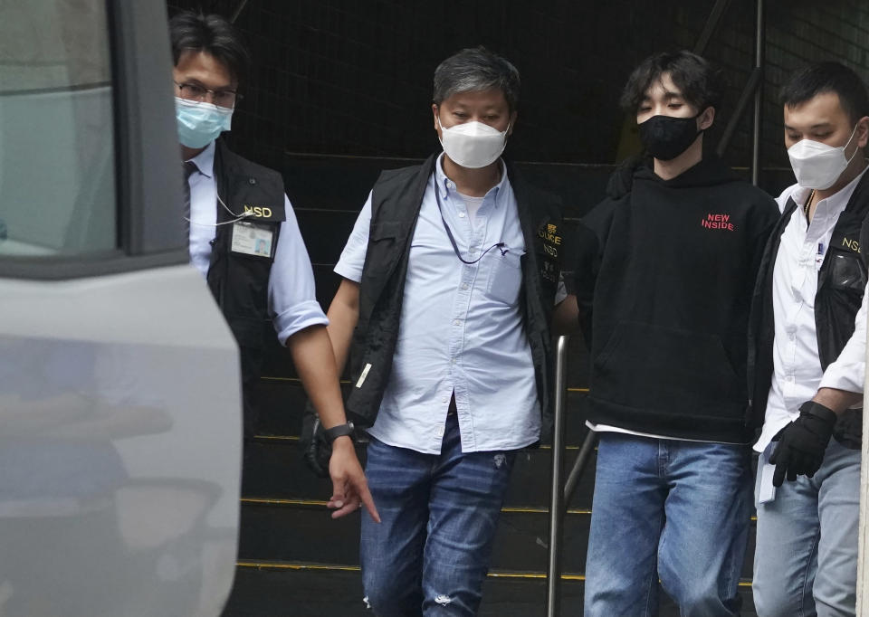 Wong Yat-chin, second from right, leader of Hong Kong Student Politicism escorted after being arrested by national security police in Hong Kong, Monday, Sept. 20, 2021. Hong Kong national security police on Monday arrested at least two members of the Hong Kong Student Politicism, including Wong and and secretary Chan Chi-sum, amid a sweeping crackdown on dissent in the semi-autonomous Chinese city. (AP Photo)