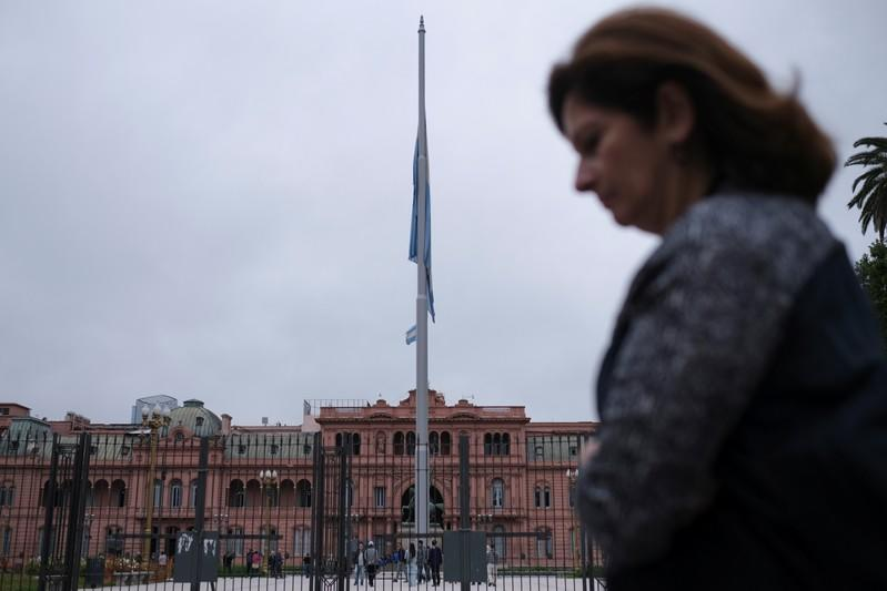 FILE PHOTO: People walk in front of the Presidential Palace in Buenos Aires