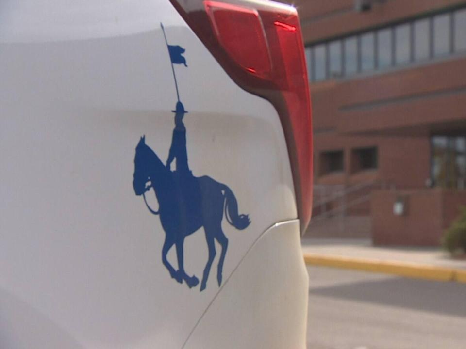 Pictured in closeup is the RCMP car insignia showing a mounted police officer in silhouette. (Matthew Howard/CBC - image credit)