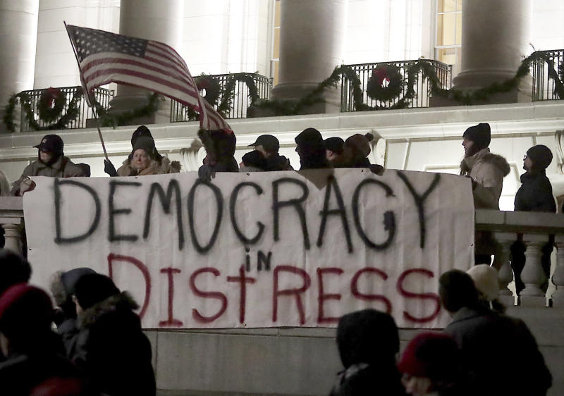 Protesters have gathered at the Wisconsin state capitol in recent days to protest a power grab aimed at undercutting Democrats by the GOP-controlled lame duck Legislature.
