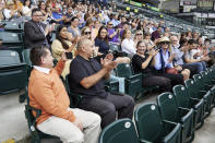 Hector Calderon, Oregon's first COVID-19 patient, second from left, is applauded during an event announcing the end of the state's COVID-19 restrictions in Portland, Ore., Wednesday, June 30, 2021. (AP Photo/Craig Mitchelldyer)