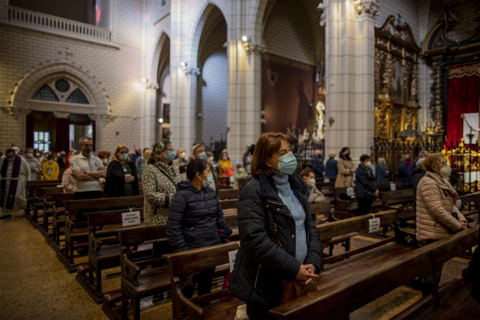 "People wearing face masks to protect against the spread of coronavirus attend a mass at Santa Cruz church in downtown Madrid, Spain, Wednesday, March 31, 2021. Spain is bracing for another potential sharp increase in coronavirus cases. And with the vaccine rollout being outpaced by the new more contagious variant of the virus, authorities are asking for citizens to intensify their precautions to ""buy time"" for the shots to arrive. (AP Photo/Manu Fernandez)"