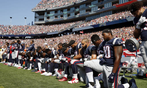 Several New England Patriots players kneel during the national anthem before Sunday's game against the Houston Texans. (AP)
