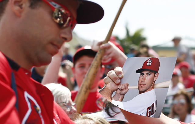 St. Louis Cardinals' Paul Goldschmidt (46) signs autographs for fans before an exhibition spring training baseball game against the Miami Marlins on Wednesday, March 13, 2019, in Jupiter, Fla. (AP Photo/Brynn Anderson)