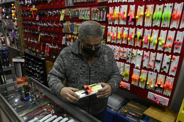 A salesman checks a floating fishing tackle for sale at a his store, after lockdown measures to fight COVID-19 were relaxed in Buenos Aires