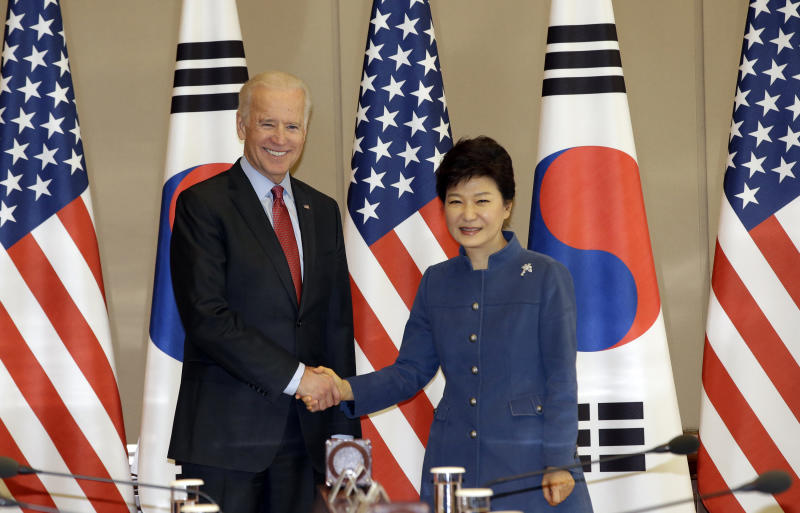 South Korean President Park Geun-hye, right, shakes hands with U.S. Vice President Joe Biden before their meeting at the presidential Blue House in Seoul, South Korea, Friday, Dec. 6, 2013. (AP Photo/Lee Jin-man)