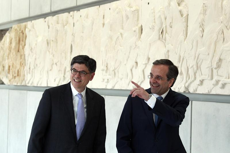Greek Prime Minister Antonis Samaras, right, and U.S. Treasury Secretary Jack Lew, walk inside the new Acropolis Museum in Athens, Sunday, July 21, 2013. U.S. Treasury Secretary Jack Lew arrived in Athens Sunday to discuss Greece's efforts to overcome a deep debt crisis. Samaras is due to visit the United States in early August, where he will meet U.S. President Barack Obama. (AP Photo/Kostas Tsironis, Pool)