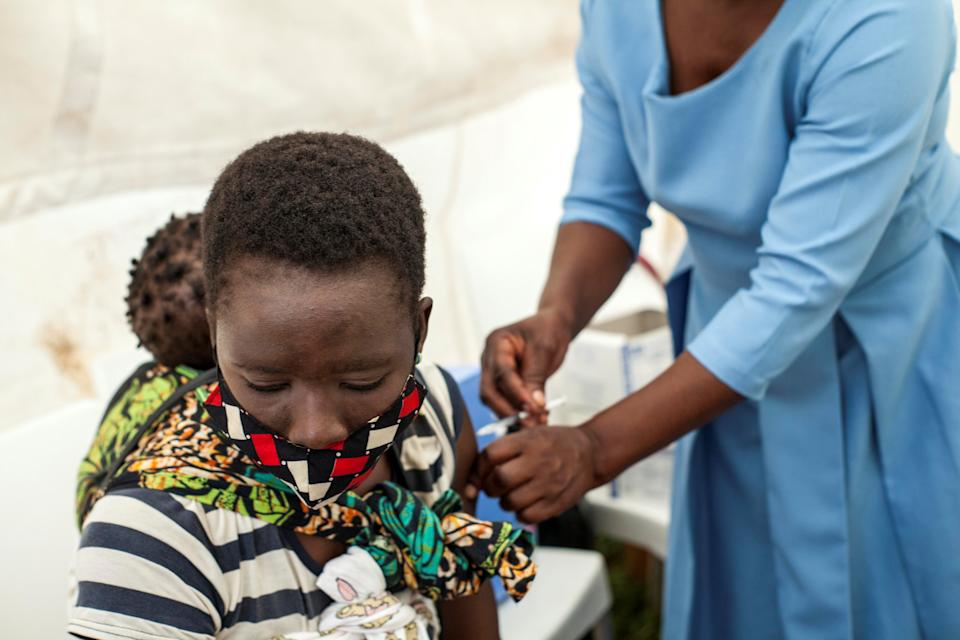 BLANTYRE, March 26, 2021 -- A woman receives the COVID-19 vaccine at a clinic in Blantyre, Malawi, on March. 26, 2021. In the first phase, the Malawi government identified priority groups to be the first to receive the COVID-19 vaccine, including all health workers and people with high risks of contracting the virus. Blantyre District Office alone has registered about 12,000 recipients of vaccine against COVID-19 during the first phase of the campaign. (Photo by Joseph Mizere/Xinhua via Getty) (Xinhua/Joseph Mizere via Getty Images)