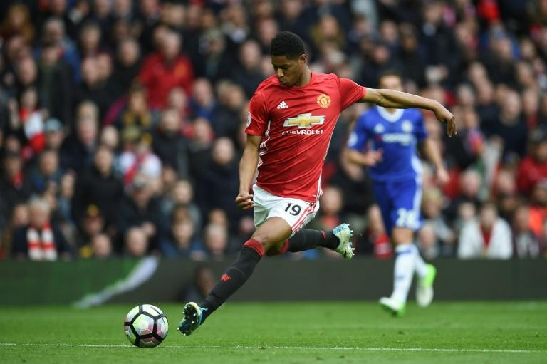 Manchester United's striker Marcus Rashford shoots but misses the target during the English Premier League football match between Manchester United and Chelsea at Old Trafford in Manchester, north west England, on April 16, 2017