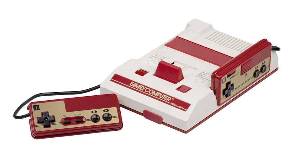 "<p>Nintendo's introduction of the Japanese Family Computer brought with it a drastically different controller. It featured a red and gold rectangular brick-like design with a cross-shaped directional pad, two round buttons labeled ""A"" and ""B"", and ""Start"" and ""Select"" buttons. </p><p>The Family Computer, or ""Famicom"" as it was nicknamed, had two controllers hardwired to the back of the system. The second controller featured a microphone in addition to the face buttons, which only a handful of games used. </p>"