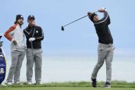 Team Europe's Tommy Fleetwood and Team Europe's Paul Casey watch the drive of Team Europe's Viktor Hovland during a practice day at the Ryder Cup at the Whistling Straits Golf Course Thursday, Sept. 23, 2021, in Sheboygan, Wis. (AP Photo/Ashley Landis)