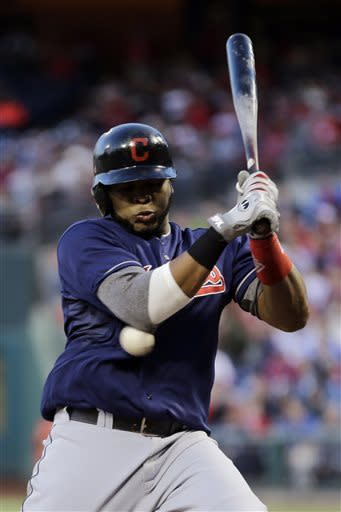 Cleveland Indians' Carlos Santana is hit by a pitch from Philadelphia Phillies' Jonathan Pettibone in the third inning of a baseball game, Tuesday, May 14, 2013, in Philadelphia. (AP Photo/Matt Slocum)
