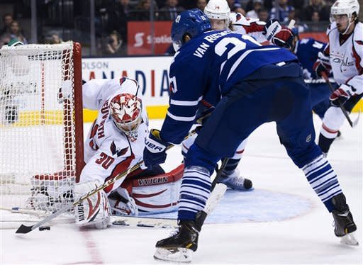 Toronto Maple Leafs forward James van Riemsdyk, right, gets stopped by Washington Capitals goalie Michal Neuvirth, left, during the second period of an NHL hockey game in Toronto on Thursday, Jan. 31, 2013. (AP Photo/The Canadian Press, Nathan Denette)
