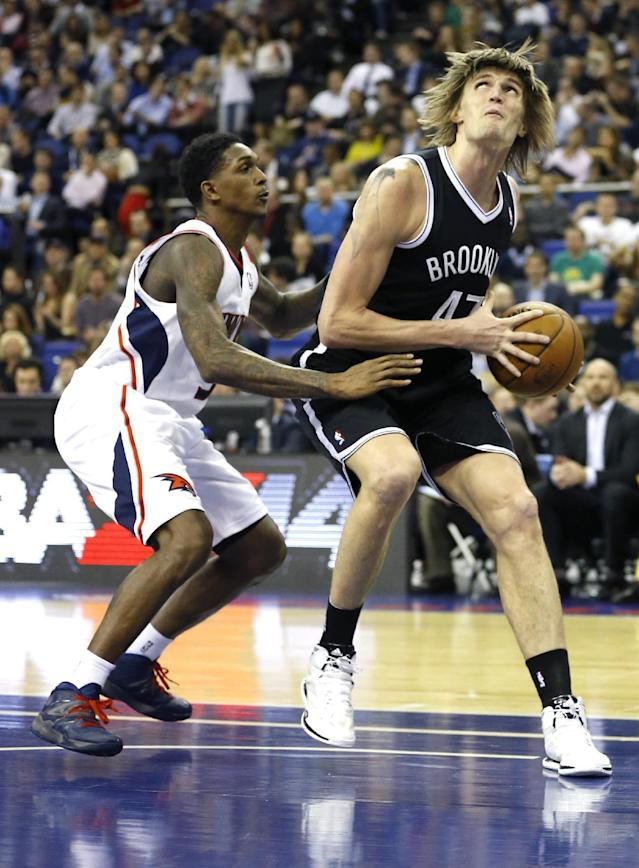 Atlanta Hawks' Louis Williams, left, vies for the ball with Brooklyn Nets' Andrei Kirilenko during an NBA basketball game at the O2 Arena in London, Thursday, Jan. 16, 2014. (AP Photo/Kirsty Wigglesworth)