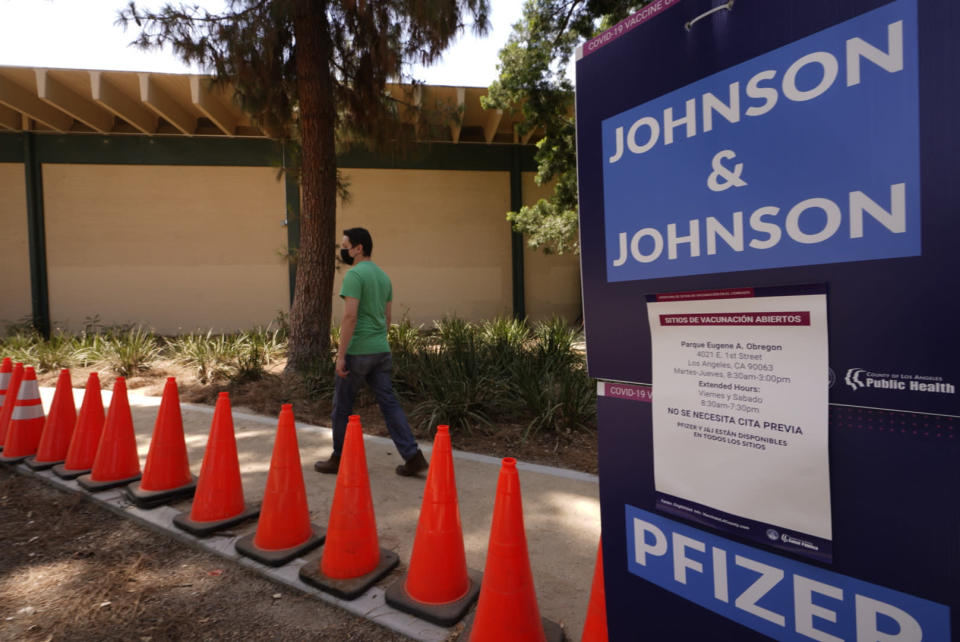 FILE - Carlos Arrendondo arrives for his appointment to get vaccinated, as banners advertise the availability of the Johnson & Johnson and Pfizer COVID-19 vaccines at a county-run vaccination site at the Eugene A. Obregon Park in Los Angeles Thursday, July 22, 2021. The number of Americans getting a COVID-19 vaccine has been rising in recent days as virus cases once again surge and officials raise dire warnings about the consequences of remaining unvaccinated. (AP Photo/Damian Dovarganes, File)