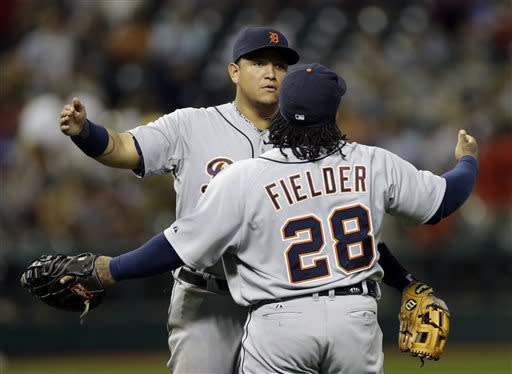 Detroit Tigers' Miguel Cabrera and Prince Fielder (28) celebrate after a 7-0 win over the Cleveland Indians in a baseball game on Friday, July 5, 2013, in Cleveland. (AP Photo/Mark Duncan)