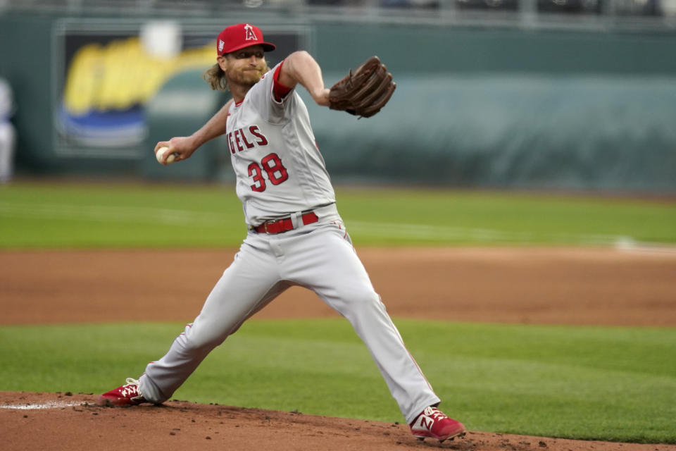 Los Angeles Angels starting pitcher Alex Cobb delivers to a Kansas City Royals batter during the first inning of a baseball game at Kauffman Stadium in Kansas City, Mo., Monday, April 12, 2021. (AP Photo/Orlin Wagner)