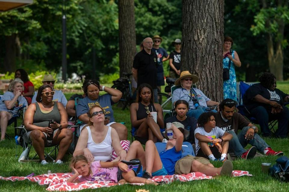Community members gather at Thompson Park for the second annual Advocacy and Awareness Peace March and Rally on Juneteenth, Saturday, June 19, 2021, in Overland Park, Kansas. Members of the community gathered to hear speakers and watch performers at the rally.