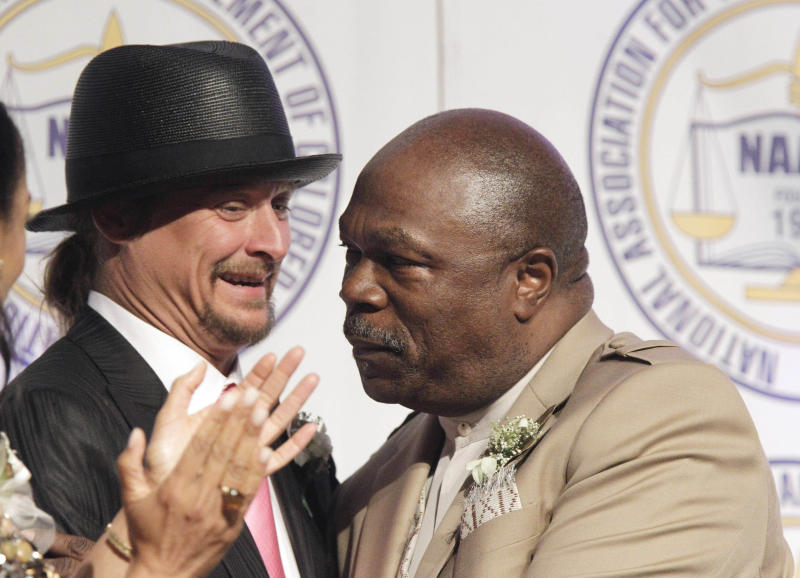Kid Rock is embraced by NAACP President Wendell Anthony at the organization's annual fundraising dinner in Detroit, Sunday, May 1, 2011. The musician has accepted the Detroit NAACP branch's Great Expectations Award during the civil rights organization's dinner. Chapter leaders say Kid Rock, a Detroit area native whose real name is Robert Ritchie, is deserving of Sunday night's honor for his support of the city. (AP Photo/Carlos Osorio)