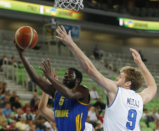 Italy's Nicolo Melli, right, tries to block Ukraine's Eugene Jeter during their EuroBasket European Basketball Championship classification 5th to 8th place play off match in Ljubljana, Slovenia, Friday, Sept. 20, 2013. (AP Photo/Petr David Josek)