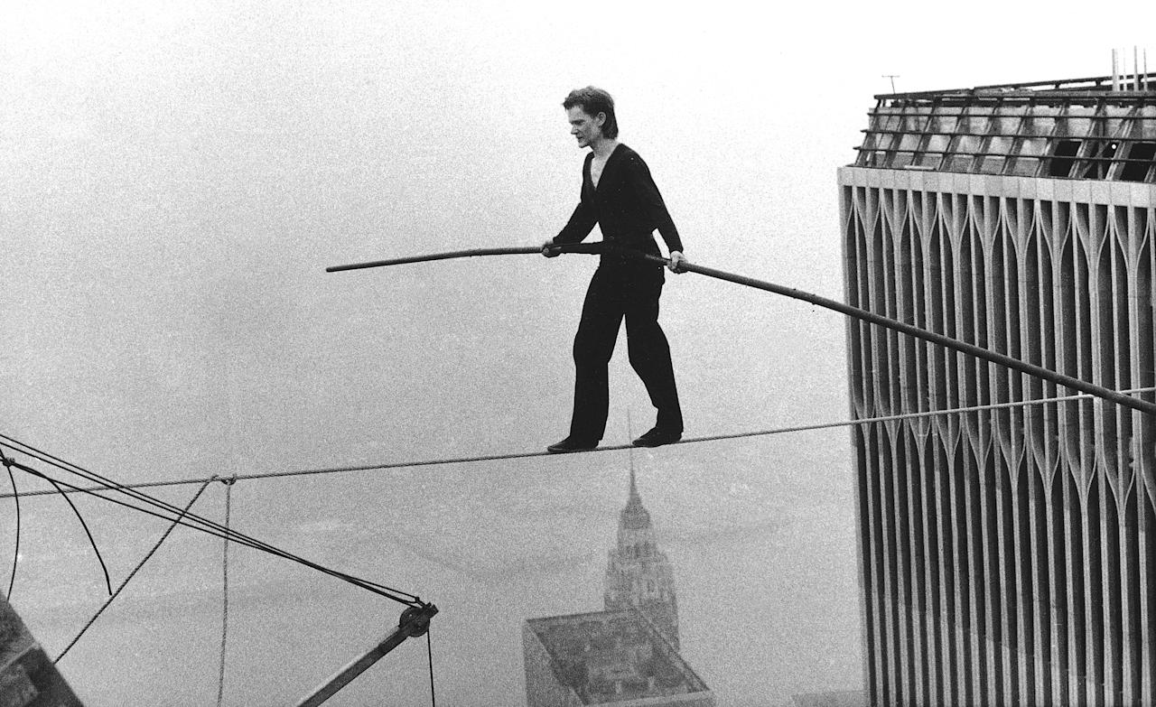 """In this Aug. 7, 1974 file photo, Philippe Petit, a French high wire  artist, walks across a tightrope suspended between the World Trade  Center's Twin Towers in New York. Philippe Petit stars in """"Man on a  Wire,"""" directed by James Marsh. (AP Photo/Alan Welner, file)"""