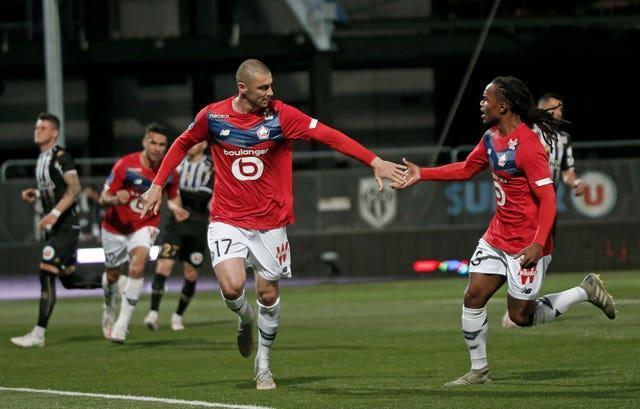 Burak Yilmaz and Renato Sanches celebrate during Lille's title-clinching victory at Angers in Ligue 1