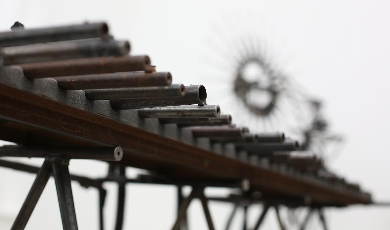 LONDON, ENGLAND - MARCH 26:  A musical instrument made from recycled gun parts is shown at Pedro Reyes' 'Disarm' exhibition at the Lisson Gallery on March 26, 2013 in London, England.  Mexican artist Pedro Reyes received 6,700 destroyed weapons from the Mexican government from which he sculpted two groups of instruments. The first, a series titled Imagine, is an orchestra of fifty instruments, from flutes to string and percussion instruments, designed to be played live. The second, Disarm, is an installation of mechanical musical instruments, which can either be automated or played live by an individual operator using a laptop computer or midi keyboard.  (Photo by Peter Macdiarmid/Getty Images)