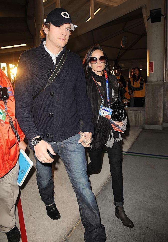 "After he finished hosting ""Saturday Night Live"" in NYC, Ashton Kutcher hopped on a plane and headed for Miami. He and his wife Demi Moore got to hang out on the sidelines snapping photos until kickoff. Gustavo Caballero/<a href=""http://www.gettyimages.com/"" target=""new"">GettyImages.com</a> - February 6, 2010"