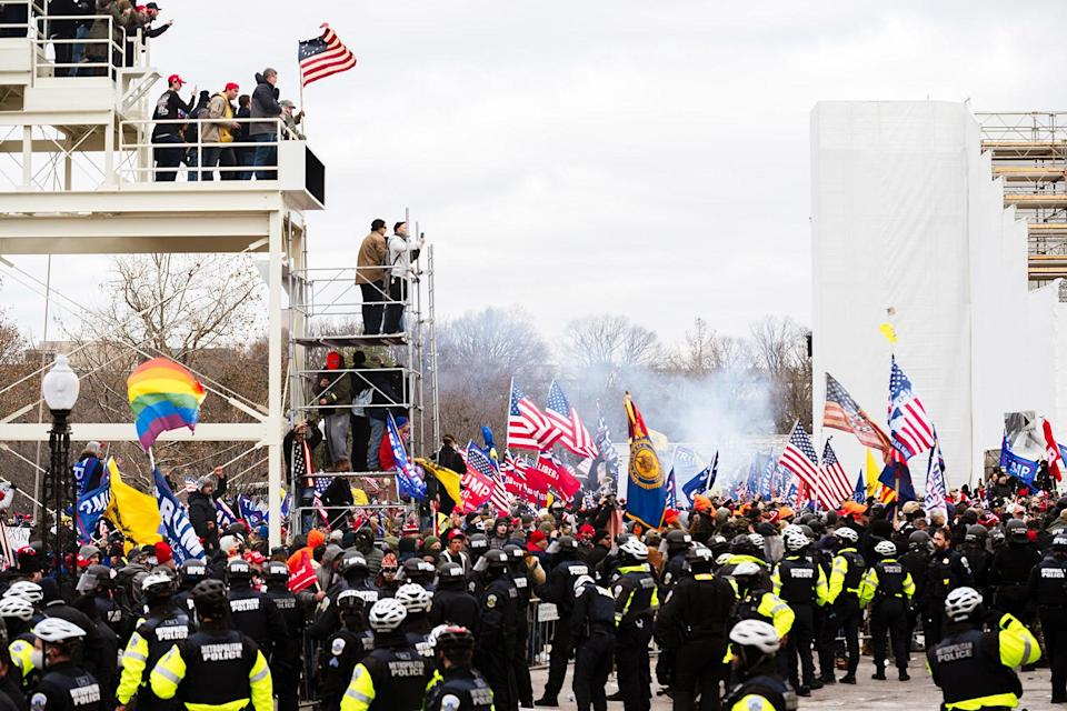 "<p>Pro-Trump rioters storm the U.S. Capitol on Jan. 6, 2021, following a rally by the president perpetuating his lies about the results of the 2020 election.</p> <p>In the wake of the November 2020 election, Trump refused to acknowledge Joe Biden's win, questioning the results of several battleground states and wrongfully claiming Biden won the election because of voter fraud and errors with mail-in ballots. His anger culminated in a rally the morning the Senate was certifying the election results — under the guidance of Vice President and Senate President Mike Pence — and later, <a href=""https://people.com/politics/dc-protest-photos-us-capitol-pro-trump-riots/"" rel=""nofollow noopener"" target=""_blank"" data-ylk=""slk:a riot in the Capitol"" class=""link rapid-noclick-resp"">a riot in the Capitol</a>, with supporters breaking glass, injuring and even killing one Capitol police officer and desecrating spaces of the sacred building. Members of Congress took shelter in offices, fearing for their lives, and Trump's refusal to outwardly denounce the violence — and his continued spread of misinformation — <a href=""https://people.com/politics/twitter-ceo-jack-dorsey-addresses-donald-trump-ban/"" rel=""nofollow noopener"" target=""_blank"" data-ylk=""slk:led social media platforms"" class=""link rapid-noclick-resp"">led social media platforms</a> including Twitter, Facebook and YouTube to ban him. As of inauguration day, dozens of people have been arrested in connection with the riot, and five people are dead. </p>"