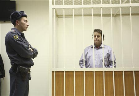 Willcox, captain of the Greenpeace ship Arctic Sunrise, sits in the defendants' cage during a court hearing in St. Petersburg