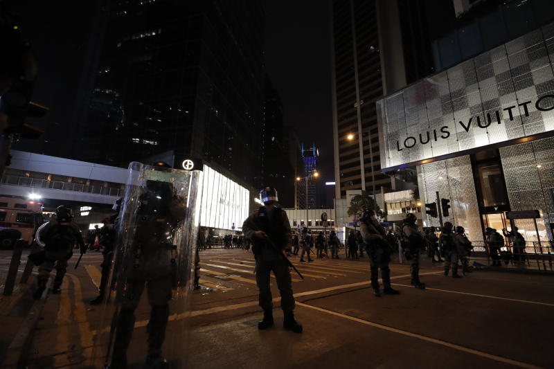Policemen stand guard in Hong Kong, Wednesday, Jan. 1, 2020. Hong Kong toned down its New Year's celebrations amid the protests that began in June and which have dealt severe blows to the city's retail, tourism and nightlife sectors. (AP Photo/Lee Jin-man)