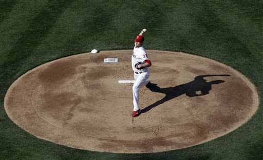 Philadelphia Phillies' Kyle Kendrick pitches in the first inning of their home-opener baseball game against the Kansas City Royals, Friday, April 5, 2013, in Philadelphia. (AP Photo/Matt Rourke)