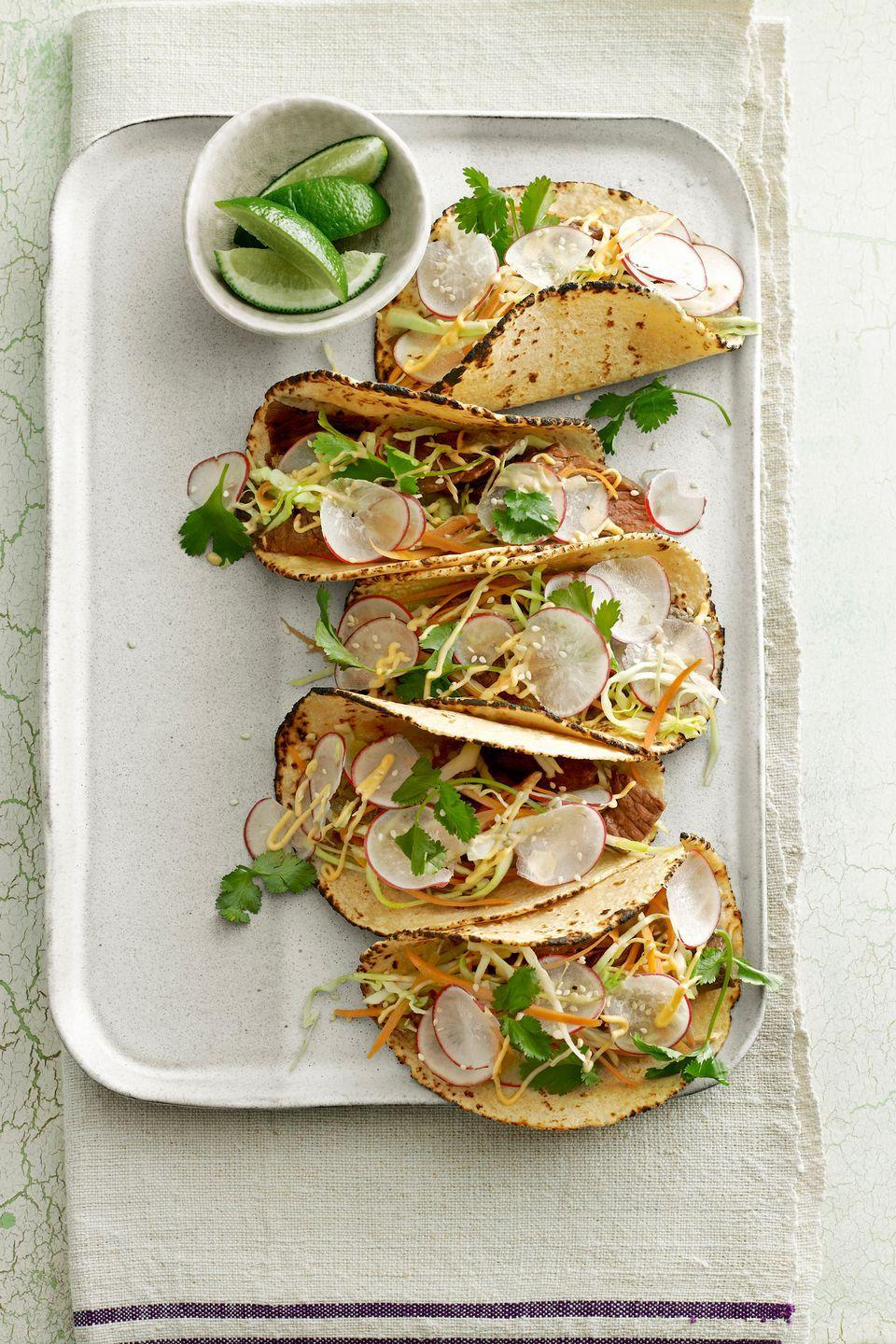 "<p>Try these Thai-inspired tacos for a twist on traditional game-day food.</p><p><strong><a href=""https://www.countryliving.com/food-drinks/recipes/a4169/thai-steak-tacos-recipe-clv0513/"" rel=""nofollow noopener"" target=""_blank"" data-ylk=""slk:Get the recipe"" class=""link rapid-noclick-resp"">Get the recipe</a>.</strong></p><p><a class=""link rapid-noclick-resp"" href=""https://www.amazon.com/Victoria-Skillet-Seasoned-Flaxseed-Certified/dp/B01726HD72/?tag=syn-yahoo-20&ascsubtag=%5Bartid%7C10063.g.35089489%5Bsrc%7Cyahoo-us"" rel=""nofollow noopener"" target=""_blank"" data-ylk=""slk:SHOP SKILLETS"">SHOP SKILLETS</a></p>"