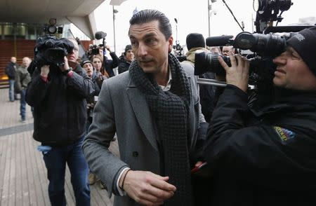 """Kris Luyckx, lawyer of Jejoen Bontinck, who is suspected of being a member of """"Sharia4Belgium"""", arrives for the verdict in the trial of the group in Antwerp February 11, 2015. REUTERS/Francois Lenoir"""