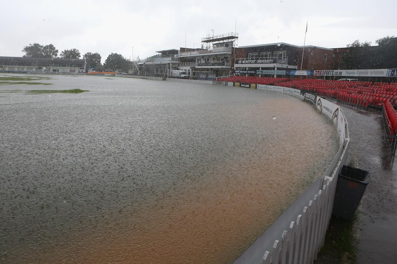 LEICESTER, ENGLAND - JULY 18:  A cloud burst floods the pitch at Grace Road during the under 19 One Day International between England and Ireland at Grace Road on July 18, 2012 in Leicester, England.  (Photo by David Rogers/Getty Images)