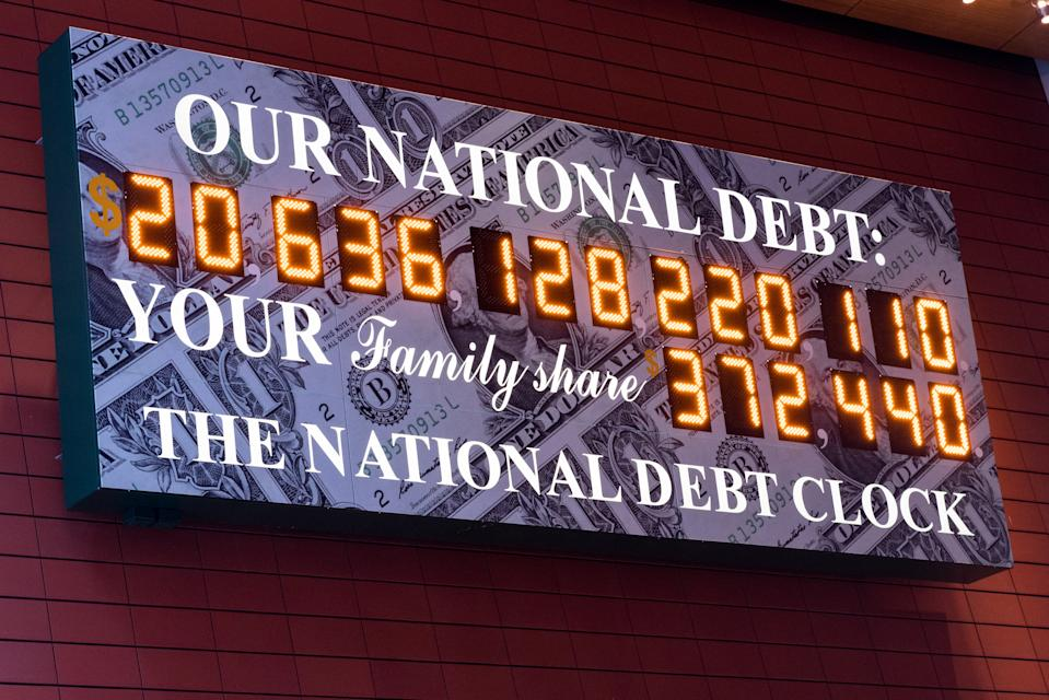 NEW YORK, NY, UNITED STATES - 2018/03/23: The National Debt Clock is a very very large digital display of the current gross national debt of the United States. It is mounted on a western facing wall in a wide covered alley in the middle of the block and runs between West 42nd Street and West 43rd Street. The alley is located between Sixth Avenue and Broadway in New York City. The displayed debt shown is as of March 23, 2018 when this image was created. (Photo by Michael Brochstein/SOPA Images/LightRocket via Getty Images)