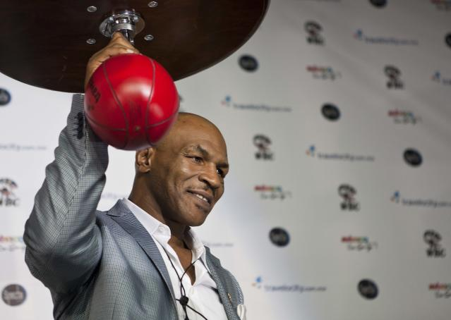 FILE- In this July 13, 2012, file photo, former heavyweight champion Mike Tyson poses for photographers during a news conference in Mexico City. Dr. Charles Butler, the head of USA Boxing, came out swinging Tuesday, Oct. 1, 2013, with an open letter to Tyson that accuses the former heavyweight champion with trying to poach fighters who might be candidates for the U.S. Olympic team in 2016. (AP Photo/Christian Palma, File)