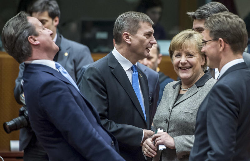 British Prime Minister David Cameron, left, laughs as he speaks with from right, Finland's Prime Minister Jyrki Tapani Katainen, Croatian Prime Minister Zoran Milanovic, German Chancellor Angela Merkel and Estonia's Prime Minister Andrus Ansip during a round table meeting at an EU summit in Brussels on Thursday, Dec. 13, 2012. In one whirlwind morning, the European Union nations agreed on the foundation of a fully-fledged banking union and Greece's euro partners approved billions of euros in bailout loans that will prevent the nation from going bankrupt. (AP Photo/Geert Vanden Wijngaert)