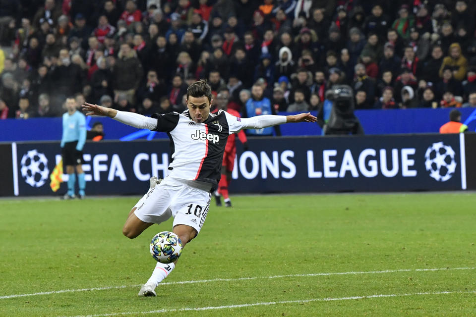 Juventus' Paulo Dybala attempts a shot at goal during the Champions League Group D soccer match between Bayer Leverkusen and Juventus at the BayArena in Leverkusen, Germany, Wednesday, Dec. 11, 2019. (AP Photo/Martin Meissner)