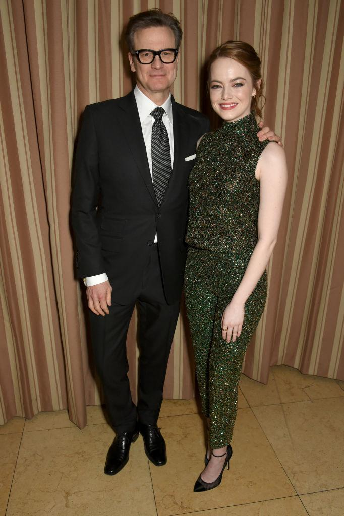 <p>Emma Stone, in Prada, and Colin Firth at the Green Carpet Challenge party (Photo: Getty Images) </p>