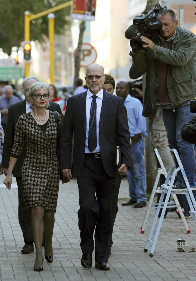 Oscar Pistorius' uncle Arnold Pistorius, right, with wife Lois, left, arrives at the high court in Pretoria, South Africa, Thursday, April 10, 2014. Pistorius is charged with murder for the shooting death of his girlfriend Reeva Steenkamp on Valentine's Day in 2013. (AP Photo/Themba Hadebe)