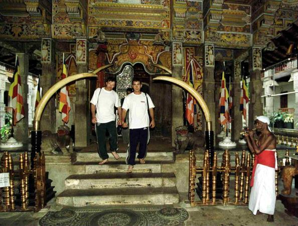 08 Sep 1999:  Steve Waugh and Justin Langer of Australia take in the sights at the Temple of the Sacred Tooth, Kandy, Sri Lanka. Mandatory Credit: Hamish Blair/ALLSPORT