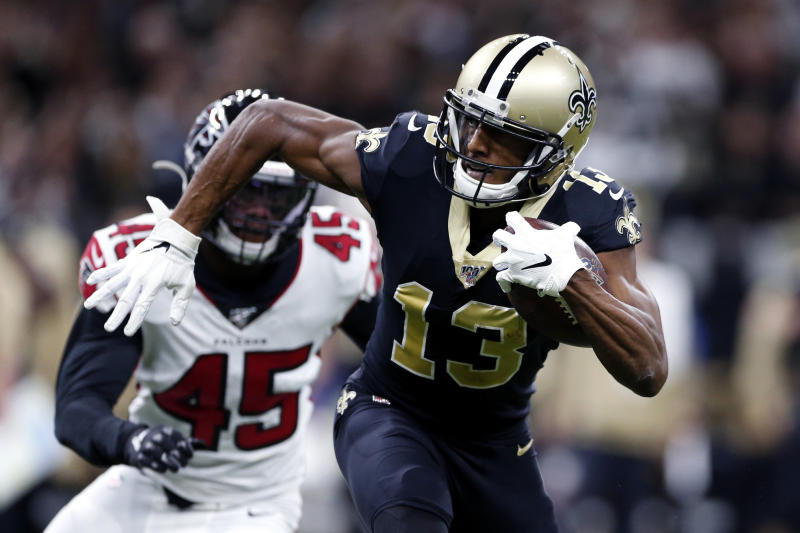 FILE - In this Nov. 10, 2019, file photo, New Orleans Saints wide receiver Michael Thomas (13) carries on a pass reception in front of Atlanta Falcons linebacker Deion Jones (45) in the first half of an NFL football game in New Orleans. Thomas could shatter the NFL record for receptions in a season, even though he was without star quarterback Drew Brees for more than a month. (AP Photo/Rusty Costanza, File)