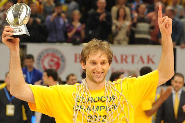 BC Khimki's Zoran Planinic poses with his MVP trophy after winning the Eurocup final basketball match between BC Khimki and Valencia in Khimki, outside Moscow on April 15, 2012. BC Khimki won 77-68. AFP PHOTO / KIRILL KUDRYAVTSEV (Photo credit should read KIRILL KUDRYAVTSEV/AFP/Getty Images)
