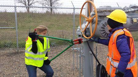 Activists are seen attempting to cut chains after trespassing into a valve station for pipelines carrying crude from Canadian oils sands into the U.S. markets near Clearbrook, Minnesota, U.S., in this image released on October 11, 2016. Photo from Climate Direct Action/Handout via Reuters
