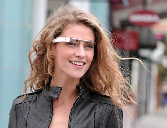 "FILE - In this undated file photo provided by the Google[x] group's ""Project Glass"", an early prototype of Google's futuristic Internet-connected glasses, are modeled. Google is making prototypes of its futuristic, Internet-connected glasses available for some computer programmers to try out. The company is selling it for $1,500 to people attending its annual conference in San Francisco for software developers. It will ship early next year and won't be available for sale outside the conference. (AP Photo/Google, File)"